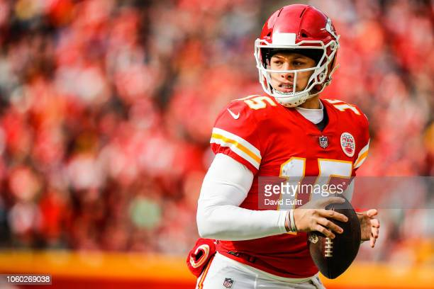 Patrick Mahomes of the Kansas City Chiefs rushes out of the pocket during the first half of the game against the Arizona Cardinals at Arrowhead...