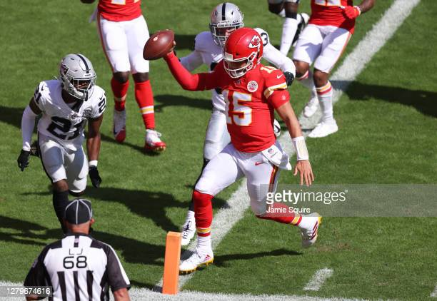 Patrick Mahomes of the Kansas City Chiefs scores a rushing touchdown against the Las Vegas Raiders during the first quarter at Arrowhead Stadium on...