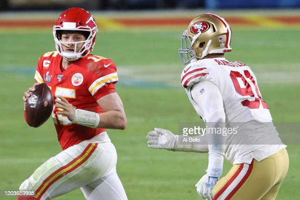 Patrick Mahomes of the Kansas City Chiefs scrambles away from Arik Armstead of the San Francisco 49ers in Super Bowl LIV at Hard Rock Stadium on...