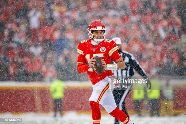 Patrick Mahomes of the Kansas City Chiefs scrambles away from defensive pressure while looking for an open receiver during the second quarter against...
