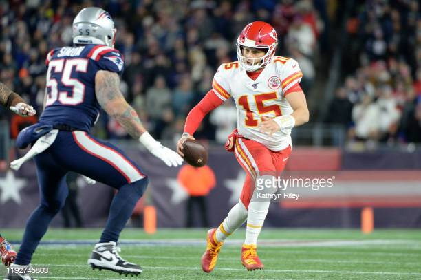 Patrick Mahomes of the Kansas City Chiefs scrambles during the first half against the New England Patriots in the game at Gillette Stadium on...