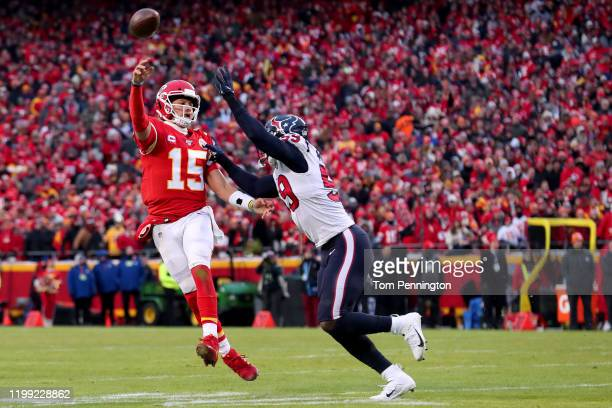 Patrick Mahomes of the Kansas City Chiefs scrambles under pressure from Whitney Mercilus of the Houston Texans in the second half of the AFC...