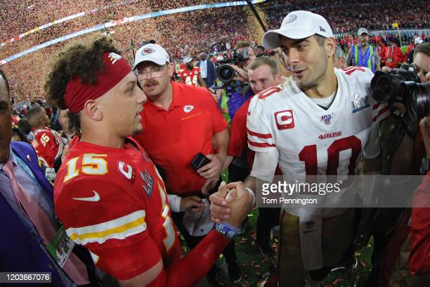 Patrick Mahomes of the Kansas City Chiefs shakes hands with Jimmy Garoppolo of the San Francisco 49ers after Super Bowl LIV at Hard Rock Stadium on...