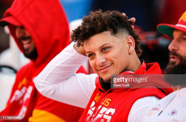 Patrick Mahomes of the Kansas City Chiefs sits on the player bench during player warmups prior to the game against the Green Bay Packers at Arrowhead...