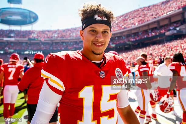 Patrick Mahomes of the Kansas City Chiefs smiles on the sidelines before the start of the game against the San Francisco 49ers at Arrowhead Stadium...