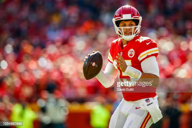 Patrick Mahomes of the Kansas City Chiefs stands in the pocket to throw a pass during the first half of the game against the Denver Broncos at...