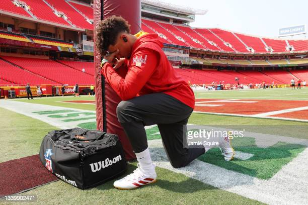 Patrick Mahomes of the Kansas City Chiefs takes a moment prior the the game against the Cleveland Browns at Arrowhead Stadium on September 12, 2021...