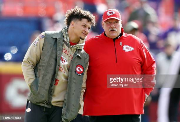 Patrick Mahomes of the Kansas City Chiefs talks with head coach Andy Reid before the game against the Minnesota Vikings at Arrowhead Stadium on...