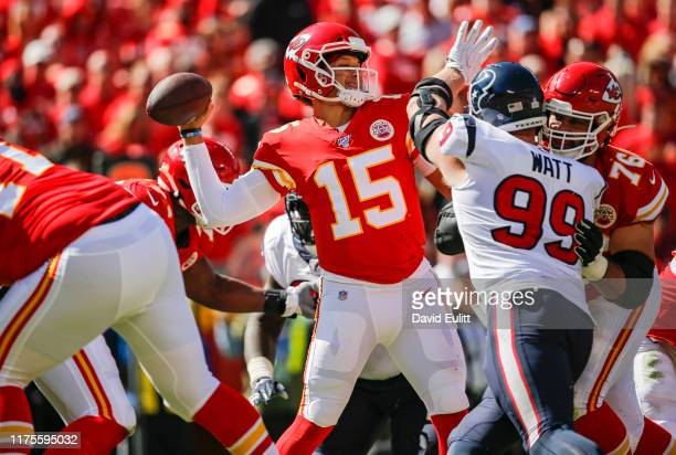 Patrick Mahomes of the Kansas City Chiefs throws a second quarter pass before the defensive pressure by JJ Watt of the Houston Texans at Arrowhead...