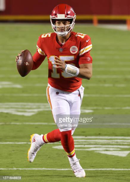 Patrick Mahomes of the Kansas City Chiefs throws a touchdown pass against the Houston Texans during the second quarter at Arrowhead Stadium on...