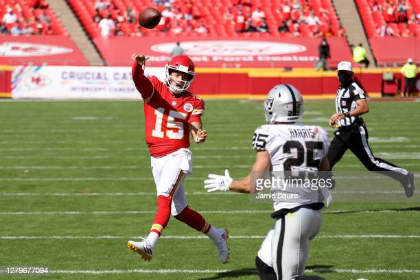 Patrick Mahomes of the Kansas City Chiefs throws a touchdown pass Sammy Watkins under pressure from Erik Harris of the Las Vegas Raiders during the...