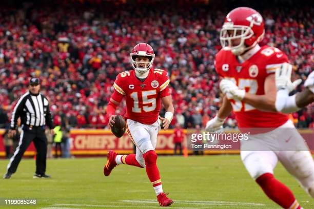 Patrick Mahomes of the Kansas City Chiefs throws a touchdown pass to Travis Kelce against the Houston Texans during the second quarter in the AFC...