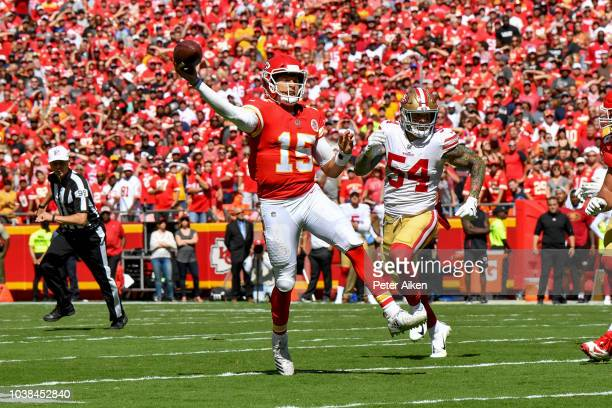 Patrick Mahomes of the Kansas City Chiefs throws on the run for a touchdown with Cassius Marsh of the San Francisco 49ers in pursuit during the...