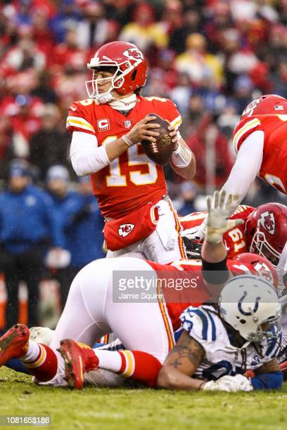 Patrick Mahomes of the Kansas City Chiefs tries to fight out of a would be tackle against the Indianapolis Colts during the first half of the AFC...