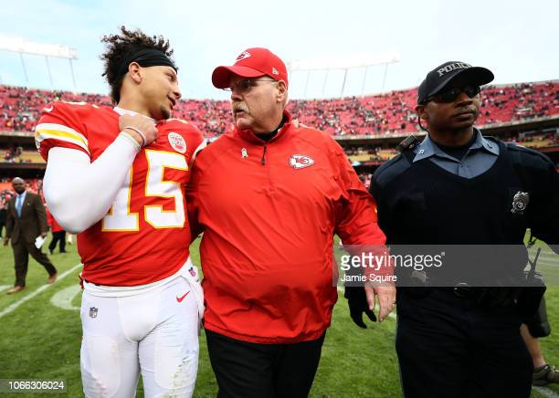 Patrick Mahomes of the Kansas City Chiefs walks off the field alongside head coach Andy Reid after the Chiefs defeated the Arizona Cardinals 2614 to...