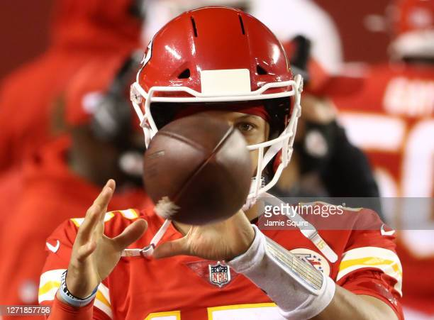 Patrick Mahomes of the Kansas City Chiefs warms up on the bench during the fourth quarter against the Houston Texans at Arrowhead Stadium on...