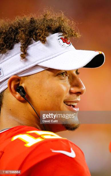 Patrick Mahomes of the Kansas City Chiefs watches game action from the sidelines against the Cincinnati Bengals at Arrowhead Stadium on August 10...