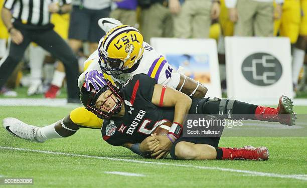 Patrick Mahomes of the Texas Tech Red Raiders gets sacked by Arden Key of the LSU Tigers in the first half of their game during the AdvoCare V100...
