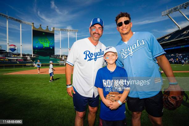 Patrick Mahomes, Rob Riggle son George Riggle before participating in a celebrity softball game at Kauffman Stadium during the Big Slick Celebrity...