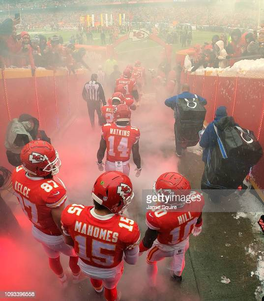 Patrick Mahomes Travis Kelce and Tyreek Hill of the Kansas City Chiefs exit the tunnel onto the field during player introductions prior to the AFC...