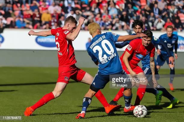 Patrick Mainka of 1 FC Heidenheim 1846 HeeChan Hwang of Hamburger SV and Marnon Busch of 1 FC Heidenheim 1846 battle for the ball during the Second...