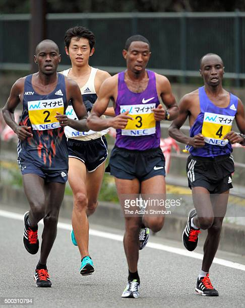 Patrick Makau of Kenya Satoru Sasaki of Japan Getu Feleke of Ethiopia and Bernard Koech of Kenya compete during the 69th Fukuoka International Open...