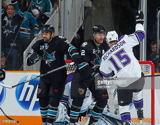 Patrick Marleau and Jamal Mayers of the San Jose Sharks celebrate Marleau's second-period goal against Brad Richardson and Jonathan Quick of the Los...