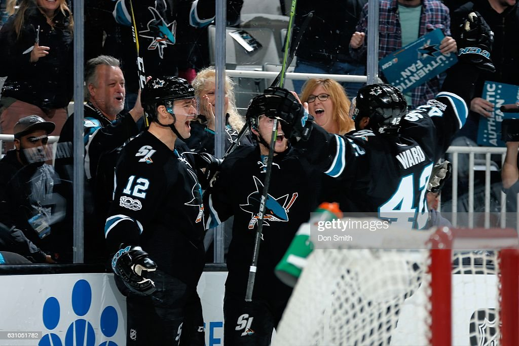 Patrick Marleau #12 and Joel Ward #42 of the San Jose Sharks celebrate Marleau's third period goal during a NHL game against the Minnesota Wild at SAP Center at San Jose on January 5, 2017 in San Jose, California.