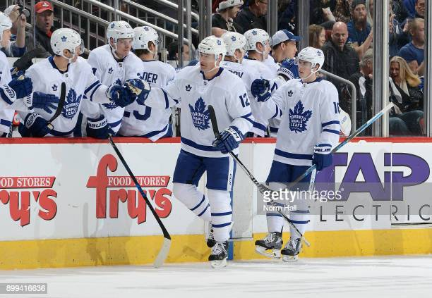 Patrick Marleau and Mitchell Marner of the Toronto Maple Leafs are congratulated by teammates after Marleau's second period goal against the Arizona...