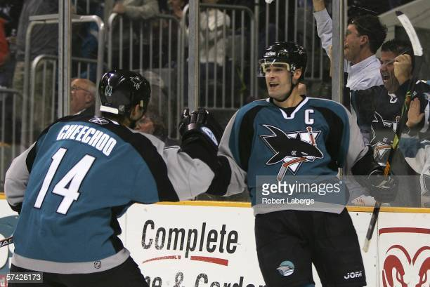 Patrick Marleau celebrates with Jonathan Cheechoo after scoring the San Jose Sharks' first goal of the game against the Nashville Predators in the...