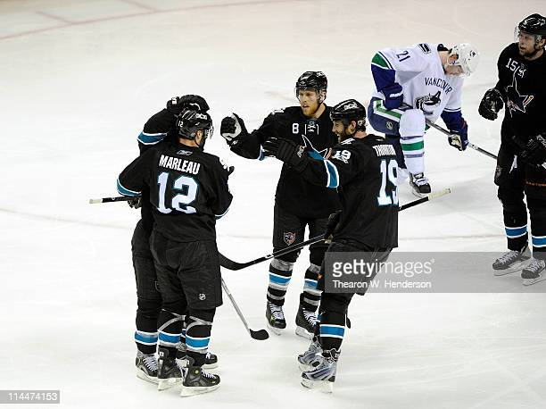 Patrick Marleau Joe Pavelski Joe Thornton and Dany Heatley of the San Jose Sharks celebrate teammate Dan Boyle of the San Jose Sharks' goal in the...