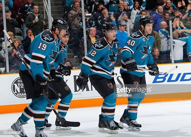 Patrick Marleau, Kent Huskins, Niclas Wallin and Joe Thornton of the San Jose Sharks celebrate Marleau's goal against the Toronto Maple Leafs during...