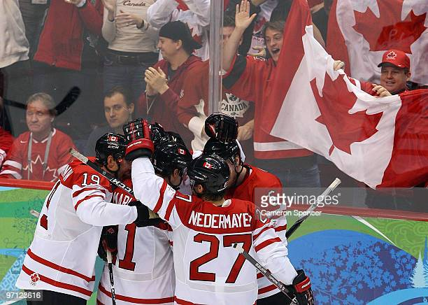 Patrick Marleau of Canada celebrates with his team mates after he scored during the ice hockey men's semifinal game between the Canada and Slovakia...