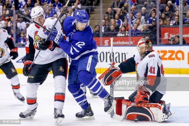 TORONTO ON FEBRUARY 10 Patrick Marleau of the Maple Leafs looks for a rebound while fending off Dion Phaneuf of the Senators and goalie Craig...