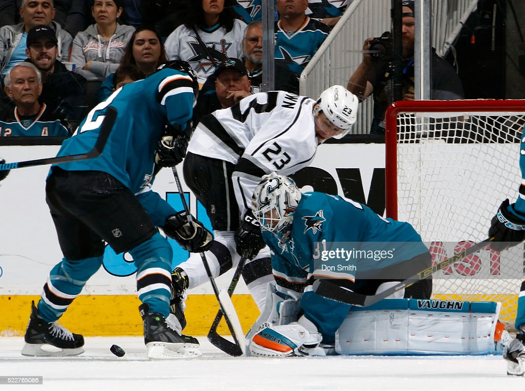 Patrick Marleau #12 of the San Jose Sharks and Dustin Brown #23 of the Los Angeles Kings skate to the front of the net where Martin Jones #31 of the San Jose Sharks makes the save against the Los Agneles Kings during the Western Conference First Round during the 2016 NHL Stanley Cup Playoffs at the SAP Center at San Jose on April 20, 2016 in San Jose, California.