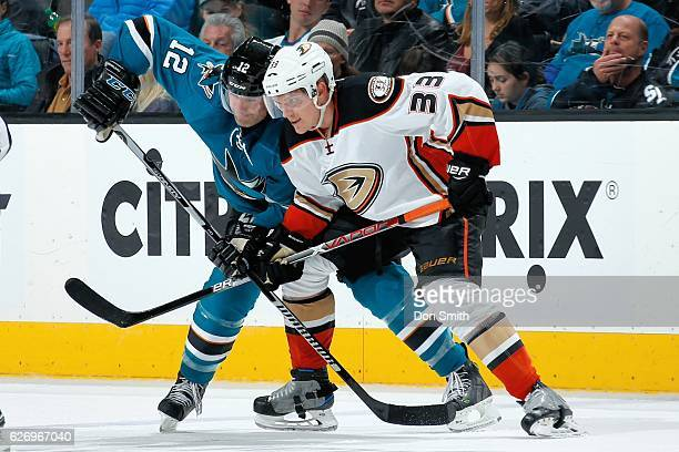 Patrick Marleau of the San Jose Sharks and Jakob Silverberg of the Anaheim Ducks get ready during a face off during a NHL game at SAP Center at San...