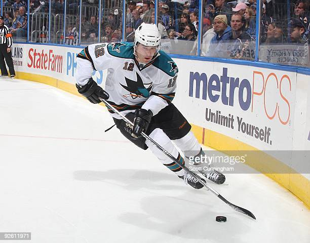 Patrick Marleau of the San Jose Sharks carries the puck against the Atlanta Thrashers at Philips Arena on October 24 2009 in Atlanta Georgia
