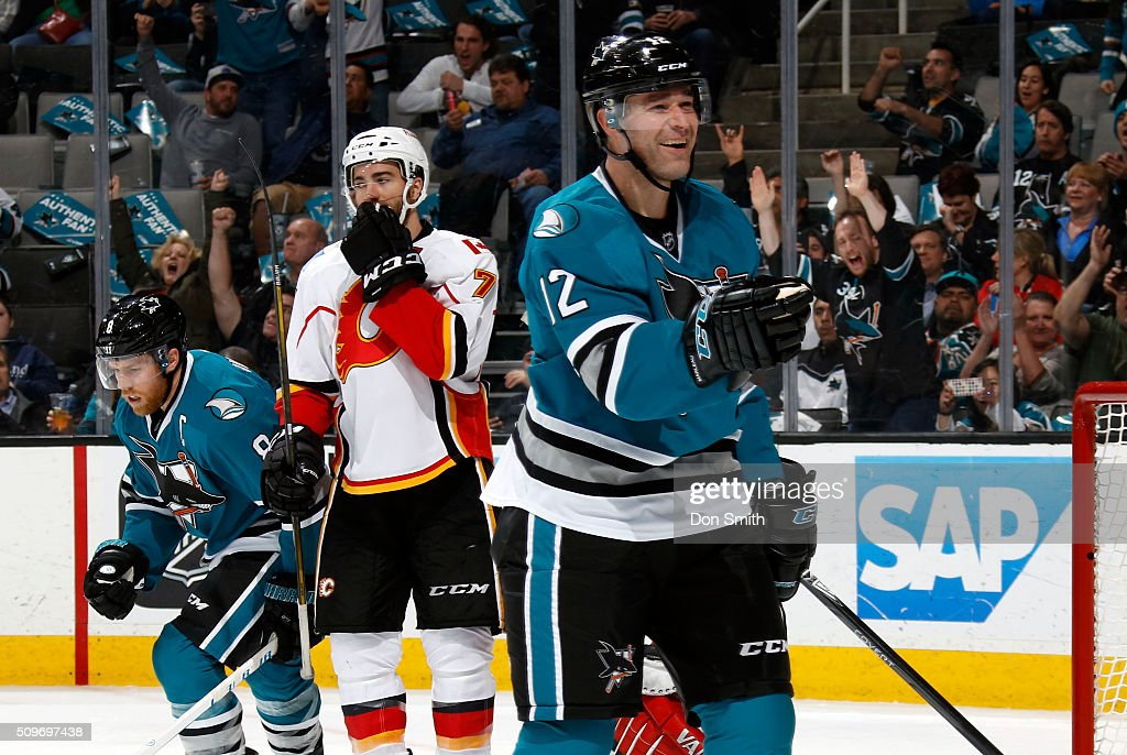 Patrick Marleau #12 of the San Jose Sharks celebrates after scoring a goal against the Calgary Flames during a NHL game at the SAP Center at San Jose on February 11, 2016 in San Jose, California.