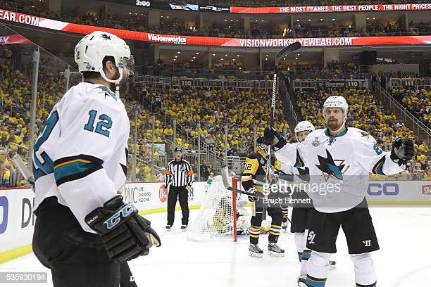 Patrick Marleau of the San Jose Sharks celebrates with Joonas Donskoi after scoring a second period goal against Matt Murray of the Pittsburgh...