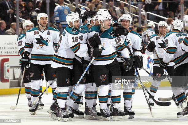 Patrick Marleau of the San Jose Sharks celebrates with teammates Ryane Clowe Devin Setoguchi MarcEdouard Vlasic and Joe Pavelski after Marleau scored...