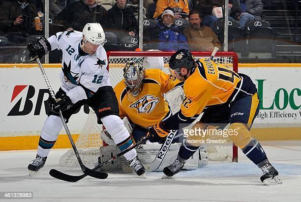 Patrick Marleau of the San Jose Sharks fights against Mattias Ekholm of the Nashville Predators for position in front of Predators goalie Marek...