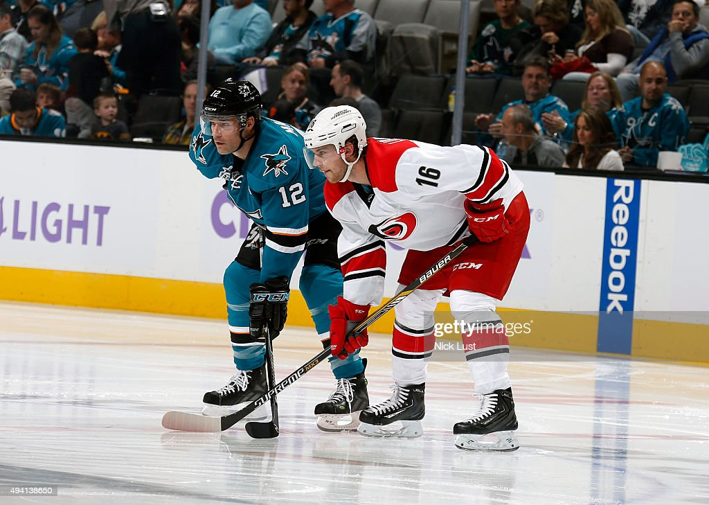 Patrick Marleau #12 of the San Jose Sharks gets gets in position for a face-off against Elias Lindholm #16 of the Carolina Hurricanes during a NHL game at the SAP Center at San Jose on October 24, 2015 in San Jose, California.