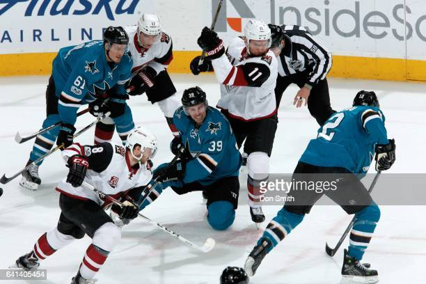 Patrick Marleau of the San Jose Sharks gets the puck after Logan Couture of the San Jose Sharks and Martin Hanzal of the Arizona Coyotes face off at...