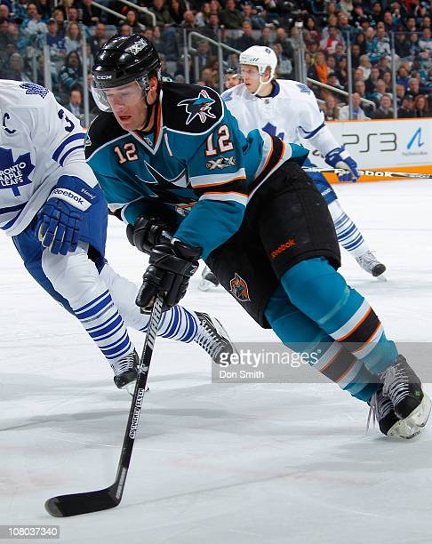 Patrick Marleau of the San Jose Sharks handles the puck against the Toronto Maple Leafs during an NHL game on January 11, 2011 at HP Pavilion at San...