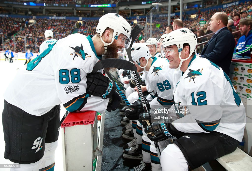 Patrick Marleau #12 of the San Jose Sharks is congratulated by teammate Brent Burns #88 after scoring his 500th NHL goal during their NHL game against the Vancouver Canucks at Rogers Arena February 2, 2017 in Vancouver, British Columbia, Canada. San Jose won 4-1.