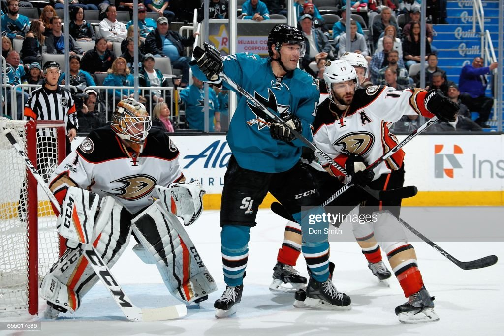 Patrick Marleau #12 of the San Jose Sharks is defended by Jonathan Bernier #1 and Ryan Kesler #17 of the Anaheim Ducks at SAP Center at San Jose on March 18, 2017 in San Jose, California.
