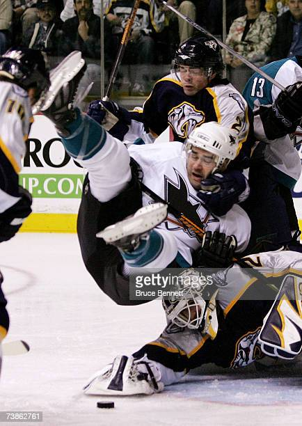 Patrick Marleau of the San Jose Sharks is dumped on top of Tomas Vokoun of the Nashville Predators by defenseman Dan Hamhuis during their 2007...