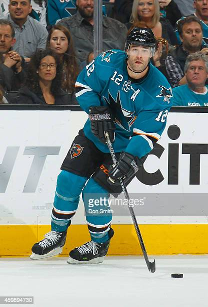 Patrick Marleau of the San Jose Sharks looks to make a pass against the Anaheim Ducks during an NHL game on November 29, 2014 at SAP Center in San...