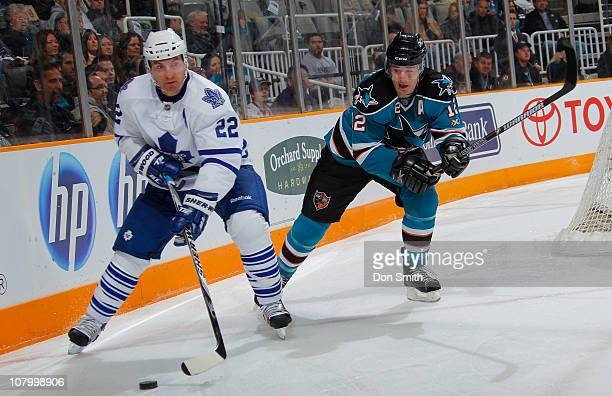 Patrick Marleau of the San Jose Sharks pursues Francois Beauchemin of the Toronto Maple Leafs during an NHL game on January 11, 2011 at HP Pavilion...