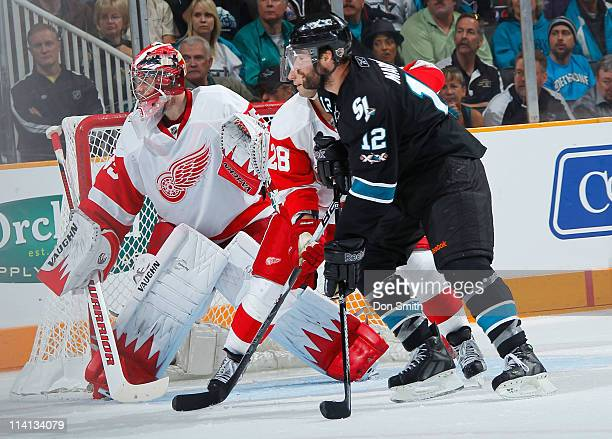 Patrick Marleau of the San Jose Sharks pursues the puck against Brian Rafalski and Jimmy Howard of the Detroit Red Wings in Game Seven of the Western...